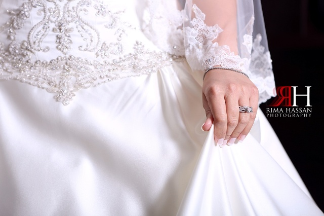 Crowne_Plaza_Wedding_Photography_Female_photographer_Dubai_UAE_Rima_Hassan_bride_holding_dress