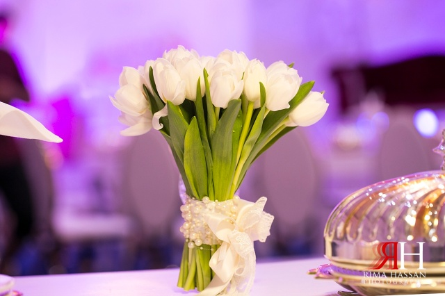 Al-Boom-Village_Wedding_Female_photographer_Dubai_UAE_Rima_Hassan_photography_stage_kosha_decoration_bridal_bouquet