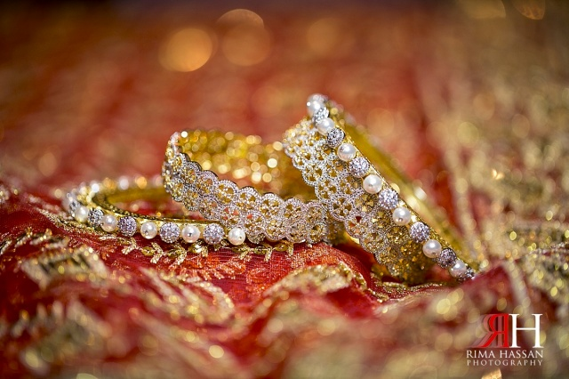 Henna_Photography_Dubai_Female_Wedding_Photographer_UAE_Rima_Hassan_indian_theme_traditional_bridal_jewelry_bangle_karay
