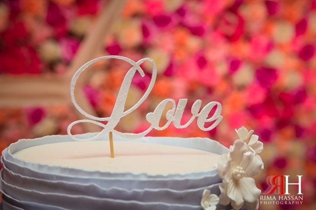 Sharjah_Ladies_Club_Wedding_Female_Photographer_Dubai_UAE_Rima_Hassan_kosha_decoration_stage_sweet_lane_cake_topper