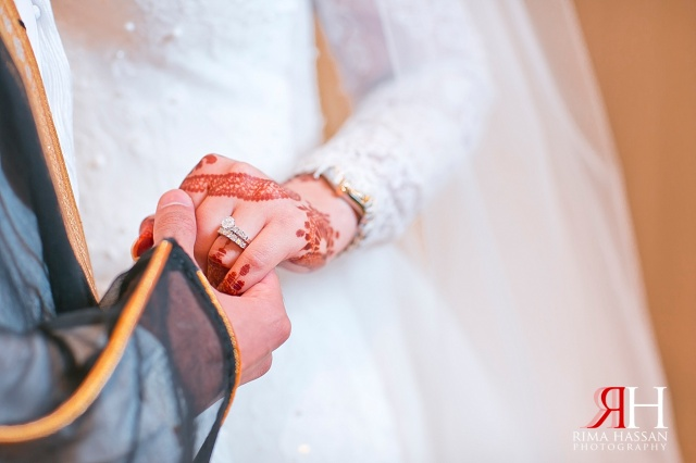 Aloft_Abu-Dhabi_Wedding_Female_Photographer_Dubai_UAE_Rima_Hassan_bride_groom_holding_hands