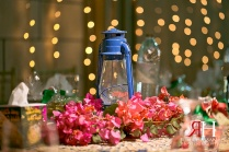 Henna_Mirdif_Wedding_Female_Photographer_Dubai_UAE_Rima_Hassan_kosha_stage_decoration_oil_lantern_centerpieces