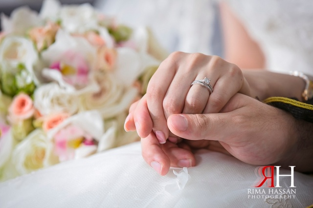 Jumeirah_Beach_Hotel_Wedding_Female_Photographer_Dubai_UAE_Rima_Hassan_bride_groom_holding_hands