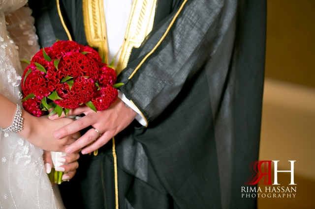 Al_Jawaher_Sharjah_Wedding_Dubai_Female_Photographer_Rima_Hassan_bride_groom_holding_hands_bouquet