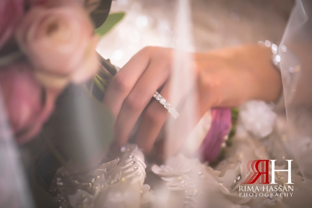 Grand_Hyatt_Dubai_Wedding_Female_Photographer_Rima_Hassan_bridal_jewelry_hand_veil