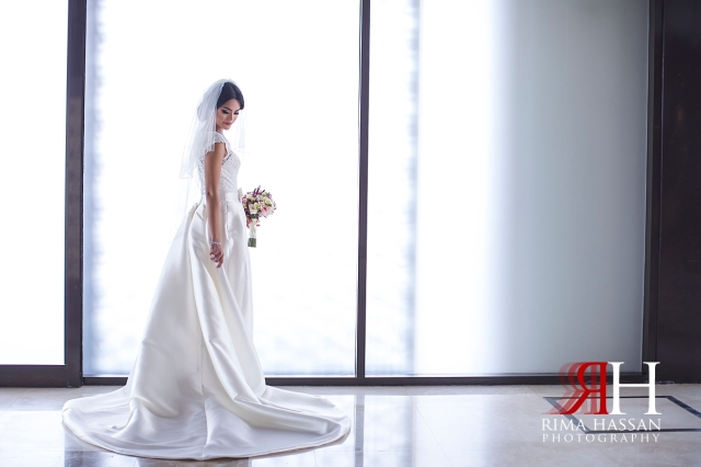 Dubai_Wedding_Female_Photographer_Rima_Hassan_bride_looking_back