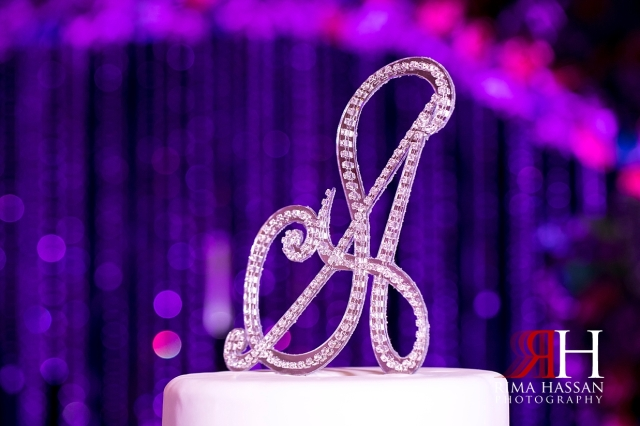 Crown_Plaza_Wedding_Dubai_Female_Photographer_Rima_Hassan_kosha_stage_decoration_ariel_cake_topper