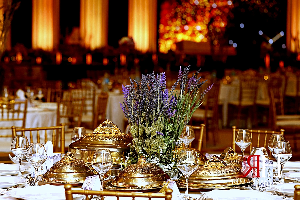 Barsha_Wedding_Female_Photographer_Dubai_Rima_Hassan_kosha_stage_decoration_purple_centerpiece