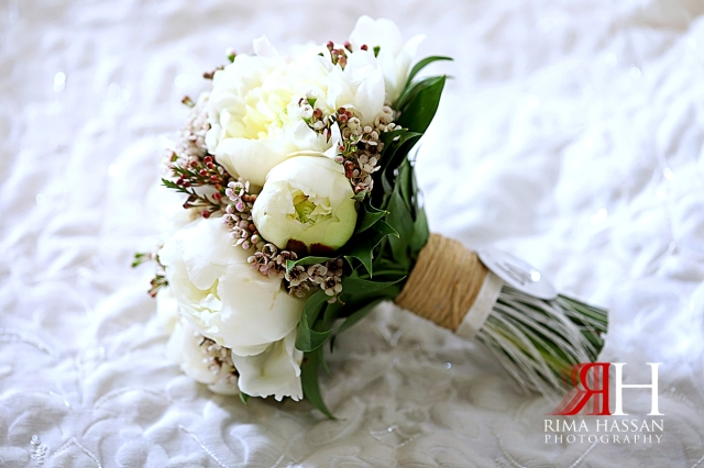 Ajman_Wedding_Female_Photographer_Dubai_Rima_Hassan_bride_bouquet_amaryllis