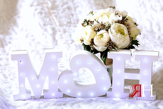 Ajman_Wedding_Female_Photographer_Dubai_Rima_Hassan_bride_groom_props_initials