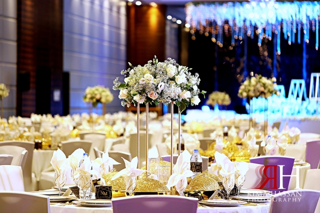 Aloft_Abu_Dhabi_Wedding_Female_Photographer_Dubai_Rima_Hassan_kosha_stage_decoration_tall_centerpiece