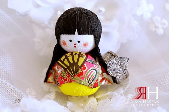 Trade_Center_Wedding_Photographer_Dubai_Rima_Hassan_bride_ring_japanese_doll