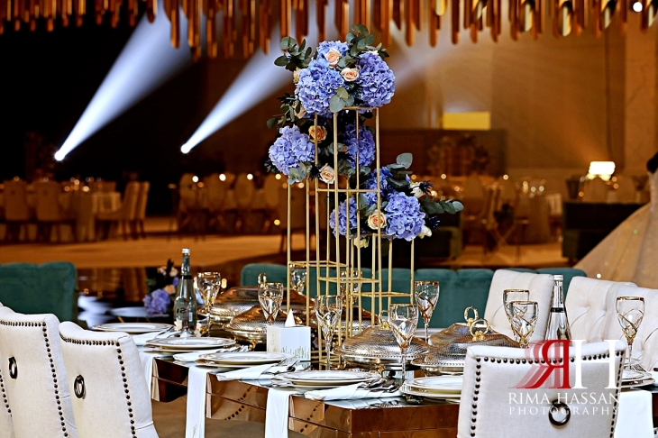 Jawaher_Sharjah_Wedding_Dubai_Female_Photographer_Rima_Hassan_stage_decoration_tall_centerpiece