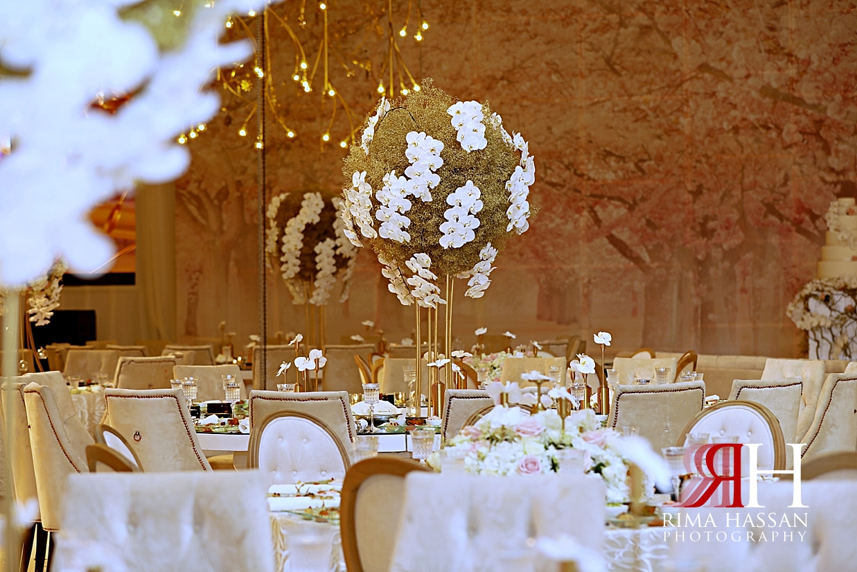 Grand_Hyatt_Wedding_Dubai_Female_Photographer_Rima_Hassan_kosha_stage_decoration_tall_centerpiece