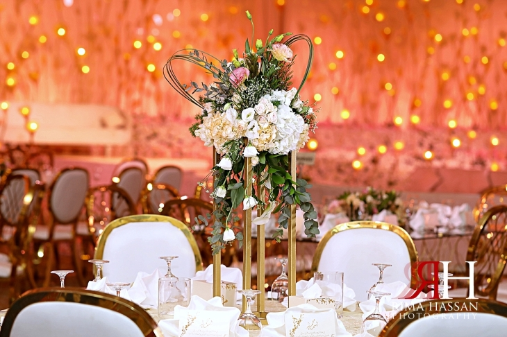 Mina_Salaam_Wedding_Dubai_Female_Photographer_Rima_Hassan_stage_kosha_decoration_tall_centerpiece